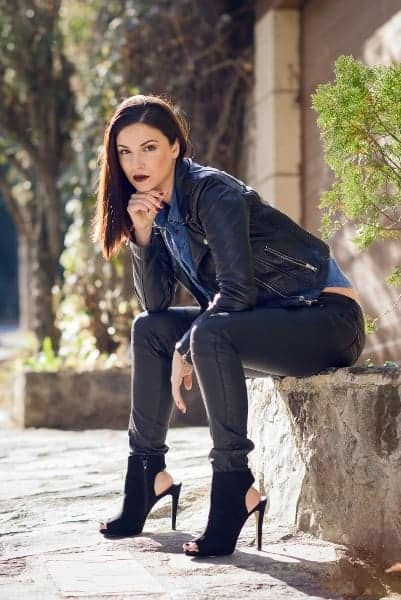 Model Sitting in Jeans and Booties