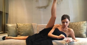 Victoria Beckham Poses on Couch with Leg Up