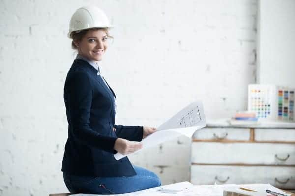 Woman at Work Smiling on Construction Site