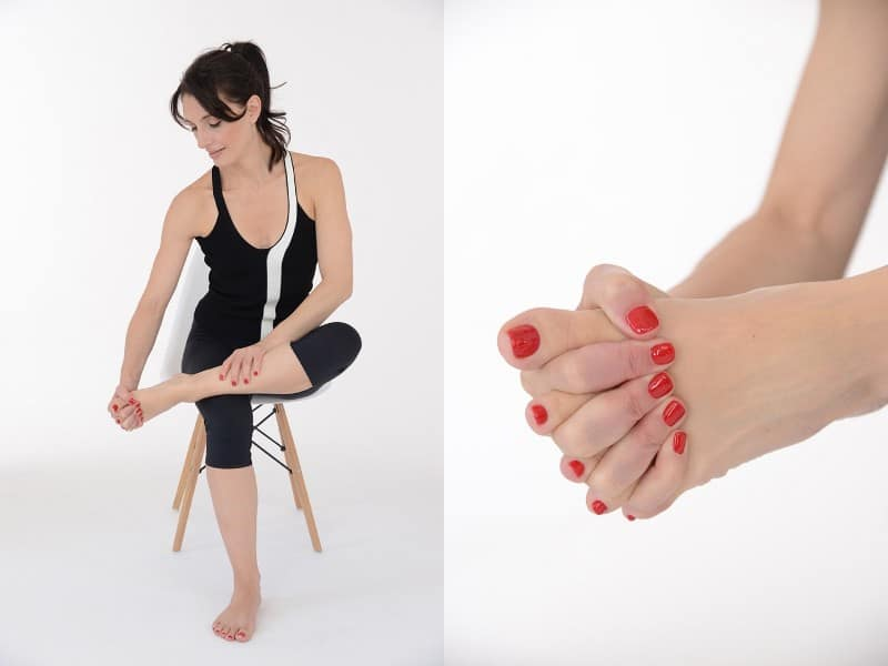 Woman Exercise Instructor with Fingers Between Toes